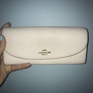 White / cream colored Coach wallet
